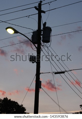 Silhouette of a street lamp at dusk - stock photo