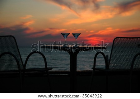 Silhouette of a table with wine glasses - stock photo