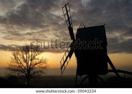 silhouette of a windmill in the sunset