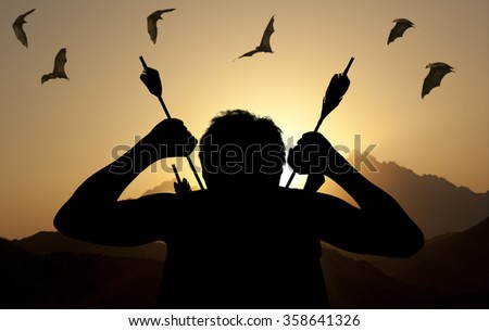 Silhouette of a witch-hunter of arrows. Fantasy concept - stock photo