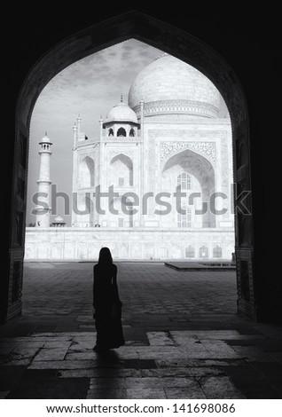 Silhouette of a woman on the Taj Mahal. - stock photo