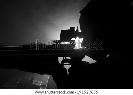 Silhouette of a woman training sport shooting with air rifle gun