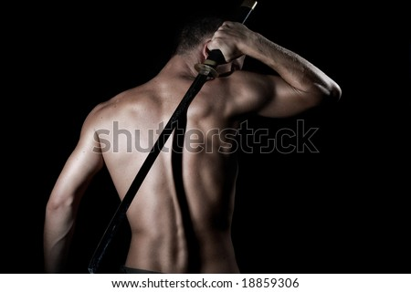 Silhouette of a young, handsome, healthy man with sword - stock photo