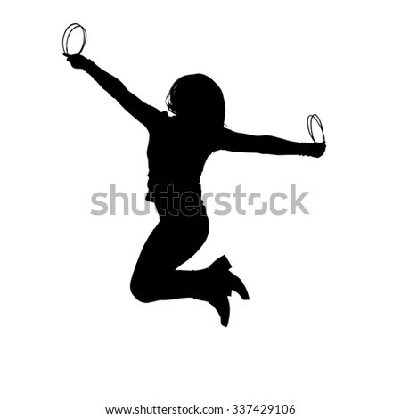Silhouette of a young woman jumping with joy while holding onto plastic rings.