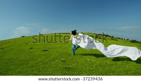 Silhouette of a young woman running into freedom - stock photo