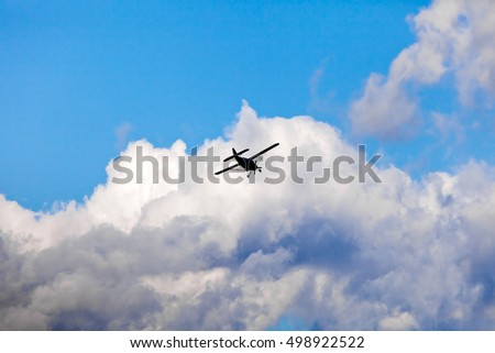 Silhouette of airplane in the blue sky