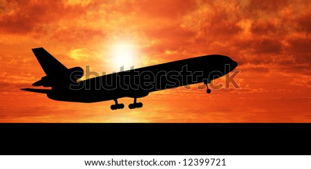 Silhouette of airplane over sunset