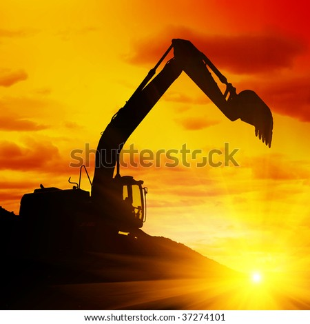 Silhouette of an excavator at sunset.