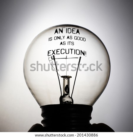 Silhouette of an incandescent light bulb with the message: An Idea is only as good as its Execution! - stock photo