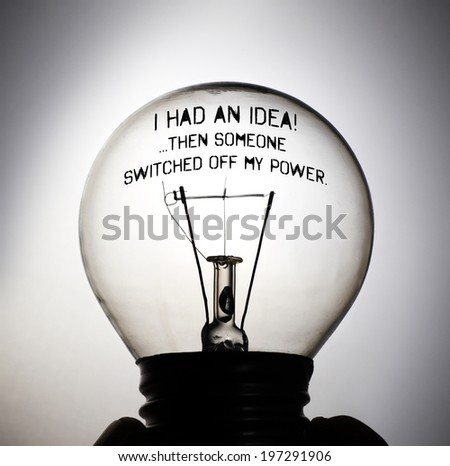 Silhouette of an incandescent light bulb with the message: I had an idea! Then someone switched off my power. - stock photo