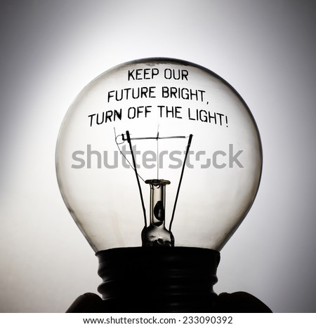Silhouette of an incandescent light bulb with the message quote: Keep our future bright, Turn off the light! - stock photo