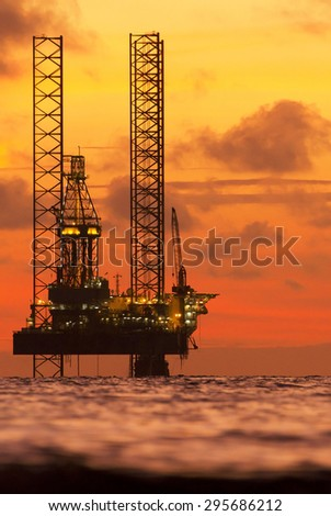 Silhouette of an offshore drilling rig in the South China Sea - stock photo