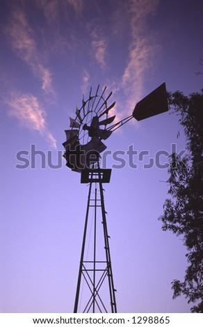 silhouette of an old windmill at sunset