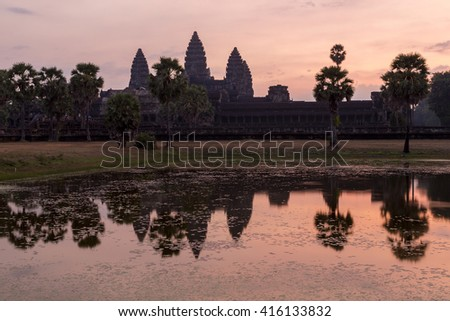 Silhouette of Angkor Wat during sunrise, the best time in the morning at Siem Reap. UNESCO Heritage Site in Cambodia - stock photo