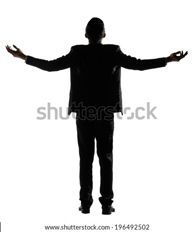 Silhouette of Asian businessman open arms feel free, rear view, full length portrait isolated on white background. - stock photo