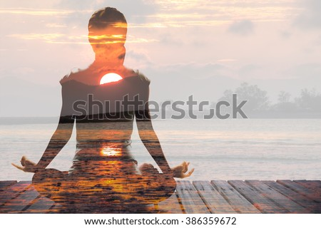 Silhouette of Asian woman yoga on the beach at the sunrise in the morning. Image by double layer technique create for business, healthcare, sport and lifestyle of people.,