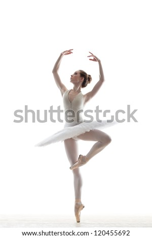 silhouette of ballerina in classical tutu in the white studio - stock photo