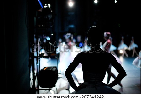 Silhouette of ballerina on background of ballet performance, backstage - stock photo