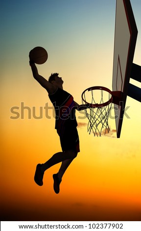 Silhouette of basketball against the sky.
