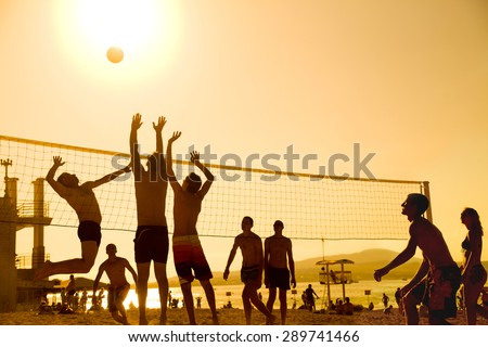silhouette of beach Volleyball player on the beach in sunset - stock photo