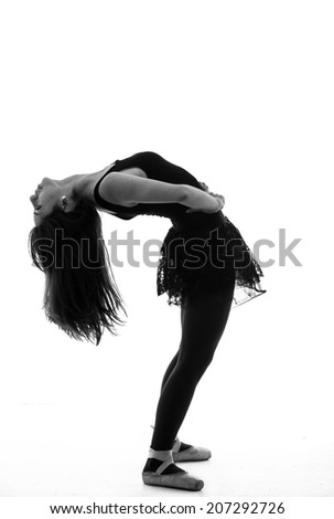 Silhouette of beautiful female ballet dancer bending backwards isolated on white in black and white - stock photo