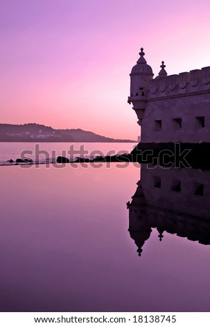 silhouette of belem tower and reflection at sunset