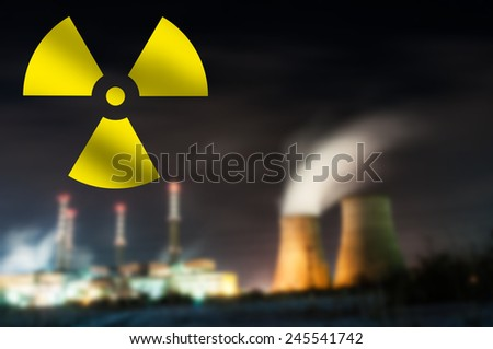 Silhouette of blurred Nuclear Power Plant. - stock photo