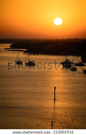 Silhouette of boats in the Atlantic ocean, Fort Myers, Lee County, Florida, USA - stock photo