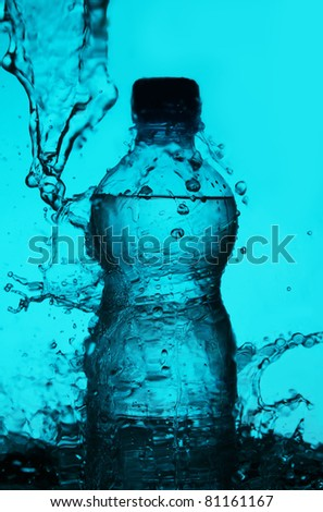 Silhouette of bottle with water splashes over blue background - stock photo