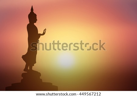 Silhouette of Buddha.Background sunrise - stock photo
