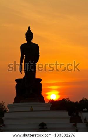 Silhouette of buddha statue - stock photo