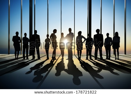 Silhouette of Business People Posing by Window - stock photo