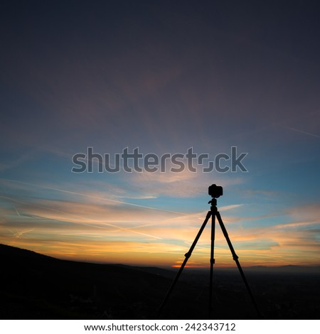 silhouette of camera on tripod  - stock photo