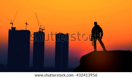 silhouette of cameraman and construction site