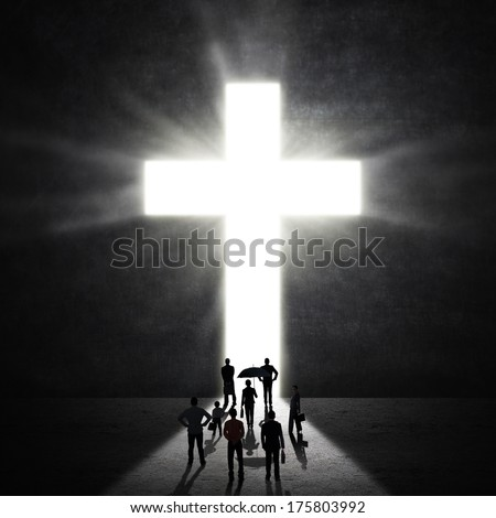 Silhouette of christian worshipers at the Cross - stock photo