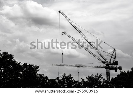 silhouette of construction site, construction crane - stock photo
