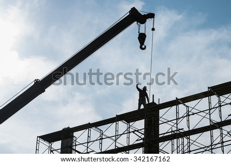 Silhouette of construction worker on scaffolding in the construction site. Unsafe or danger, Focus to people activity work.