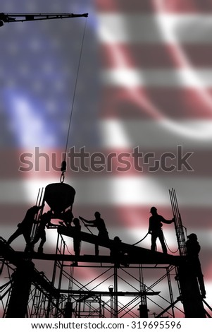 silhouette of construction worker stand on scaffolding framework casting concrete column in construction site blur United States flag background - stock photo