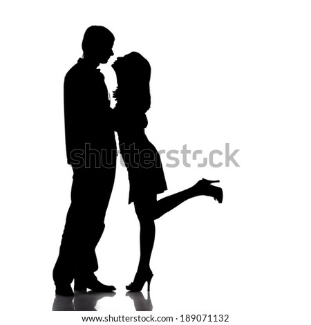 Silhouette of couple in love, kiss moment. Love and sensuality concept. Isolated on white background.