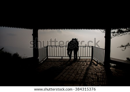 Silhouette of couple on tourists with sunrise background,Phu Rua national park,Loei province,Thailand