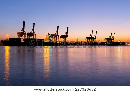 Silhouette of crane at port, twilight time. - stock photo