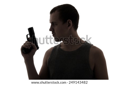 silhouette of criminal man holding gun isolated on white background - stock photo