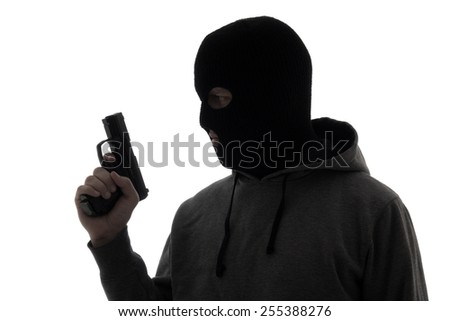 silhouette of criminal man in mask holding gun isolated on white background - stock photo