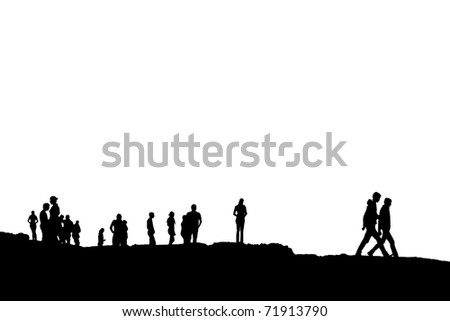 Silhouette of crowd of people on the peak or edge of a cliff in ireland with clipping path