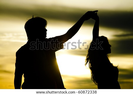 Silhouette of dancing couple - stock photo
