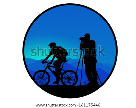 silhouette of dark mountain biker and photographer - stock photo