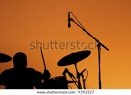Silhouette of Drummer at sunset - stock photo