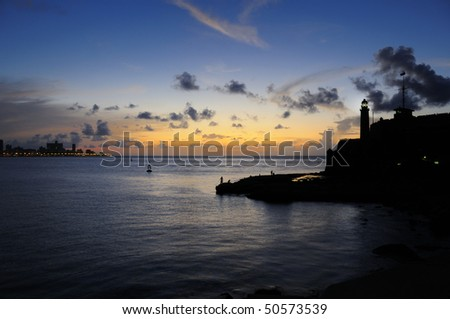 "Silhouette of ""el Morro"" fortress against sunset background - stock photo"