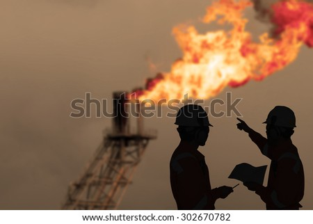 Silhouette of engineers looking at rig in sepia tone - stock photo