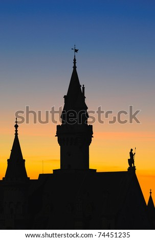Silhouette of famous Neuschwanstein castle at sunset, Bavaria, Germany. - stock photo